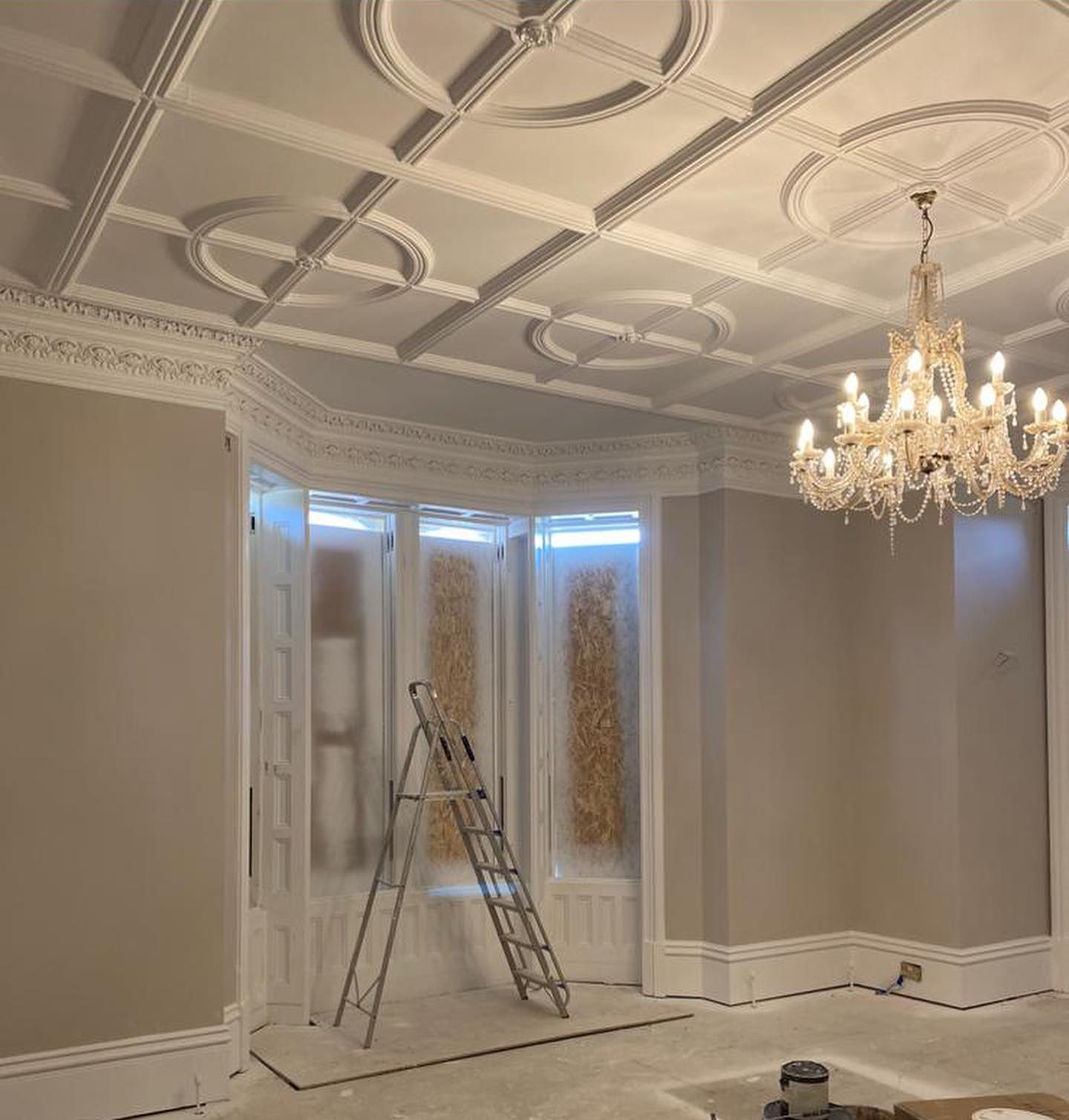 White sprayed coving in living room