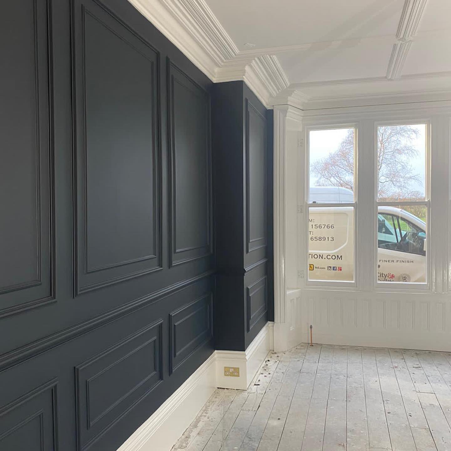 Wooden wall paneling painted black and white