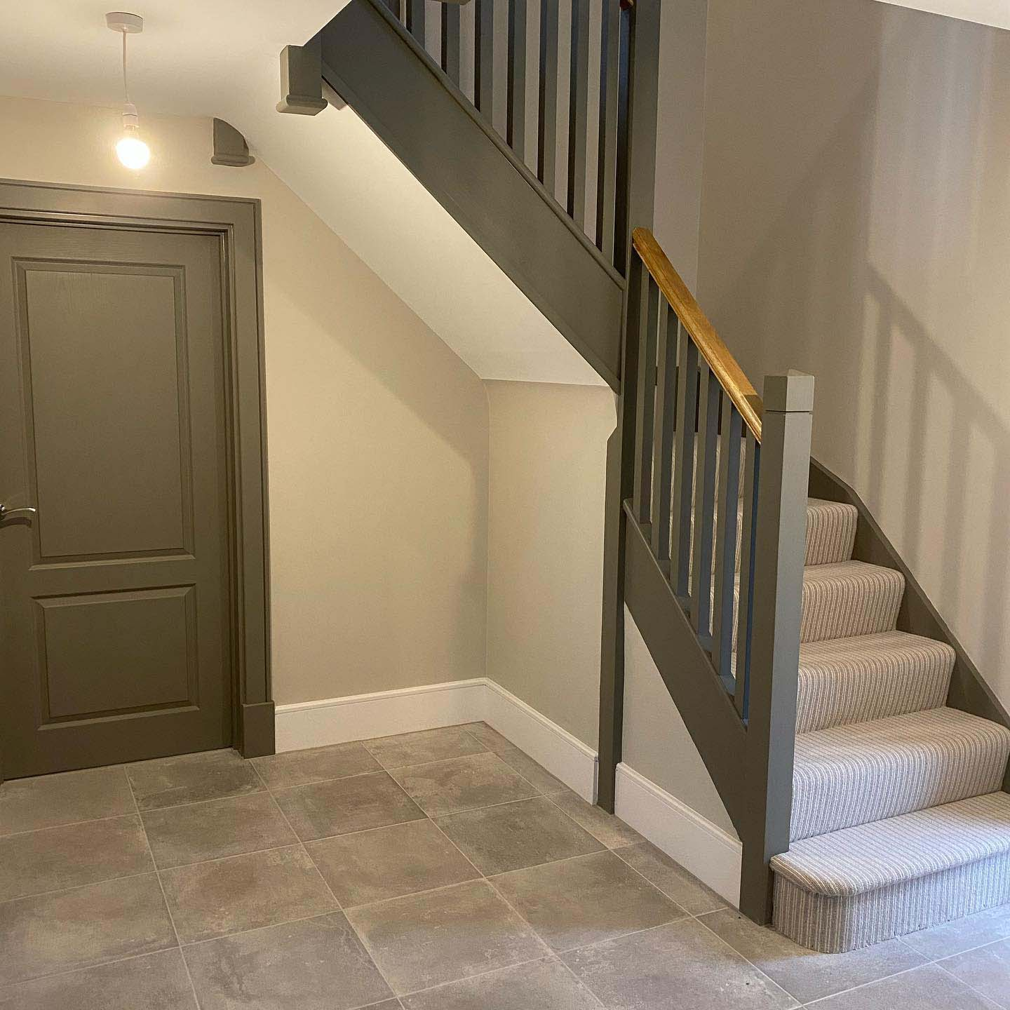 New painted staircase with grey carpet