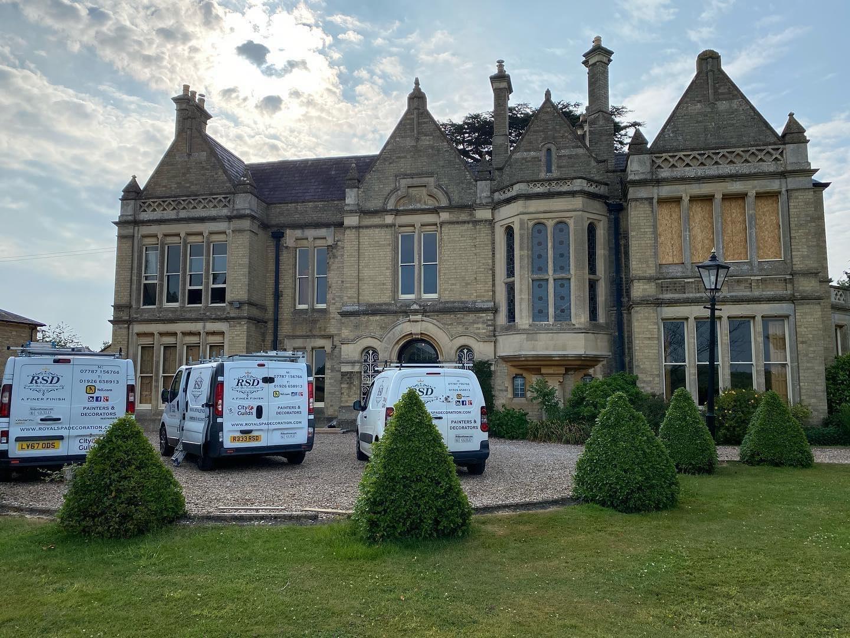 3 Royal Spa Decoration van parked outside a large estate home
